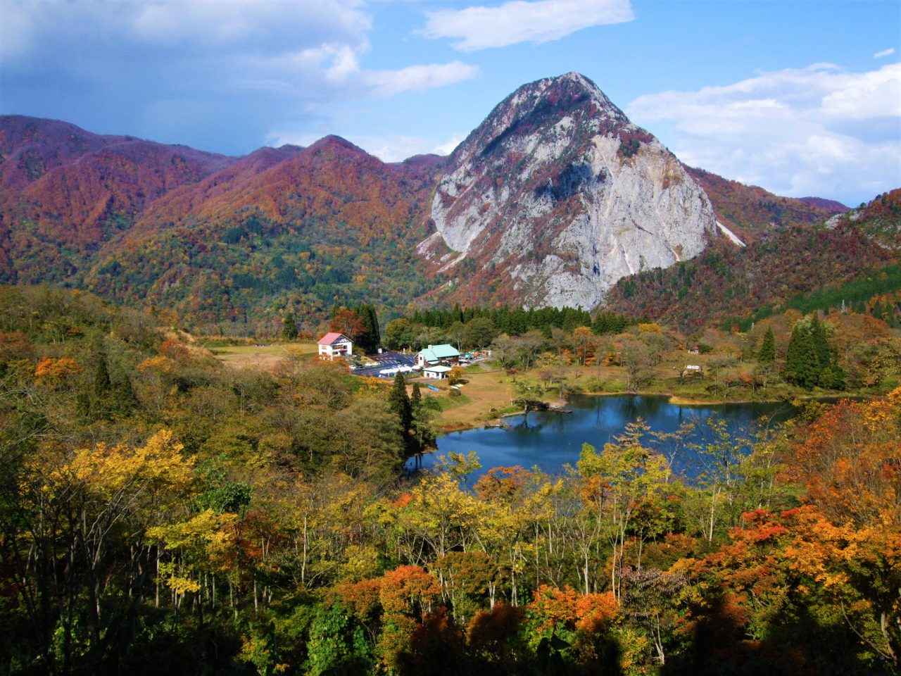 Takanami-no-Ike Pond and Mt. Myojo in Autumn