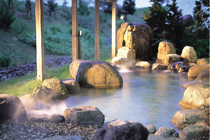 Hot spring water bubbling from fossilized sea water